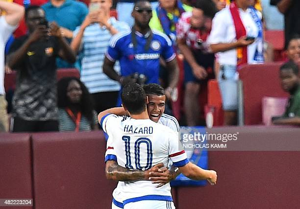 Chelsea's Eden Hazard celebrates with Kenedy after scoring against Barcelona during an International Champions Cup football match in Landover...