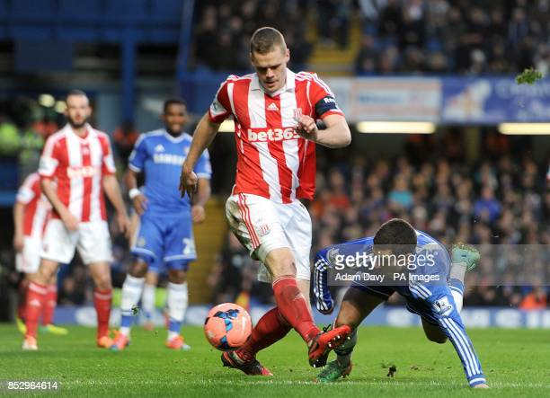 Chelsea's Eden Hazard goes down under a challenge from Stoke City's Ryan Shawcross as they battle for the ball