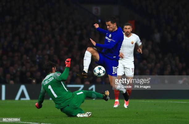 Chelsea's Eden Hazard jumps over Roma's Ramses Alisson during the UEFA Champions League Group C match at Stamford Bridge London