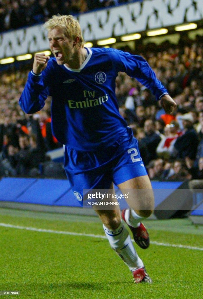 Chelsea's Eidur Gudjohnsen (L) celebrates after he scored against Arsenal during their Champions League quarter-final football match 24 March, 2004 at Stamford Bridge, London.