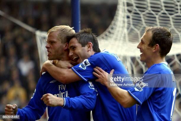 Chelsea's Eidur Gudjohnsen celebrates scoring the second goal with Frank Lampard and Arjen Robben