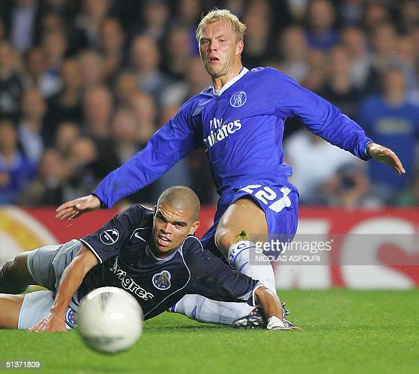 Chelsea's Eidur Gudjohnsen kicks the ball past Port's Pepe during their Champions League football match 29 September 2004 at Stamford Bridge in...
