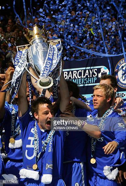 Chelsea's Eidur Gudjohnsen looks on as Captain John Terry holds aloft the Premiership trophy during the celebrations following the game against...