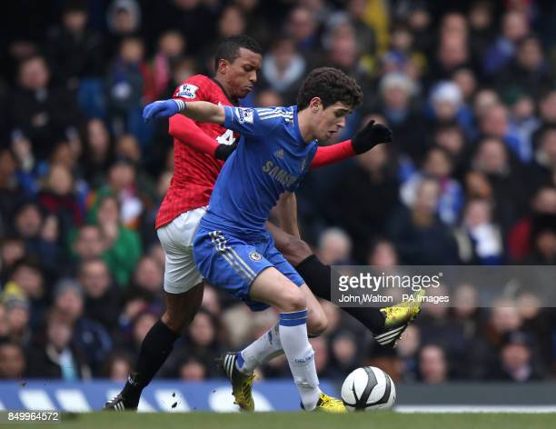 Chelsea's Emboaba Oscar and Manchester United's Nani battle for possession of the ball during the FA Cup Quarter Final Replay at Stamford Bridge...