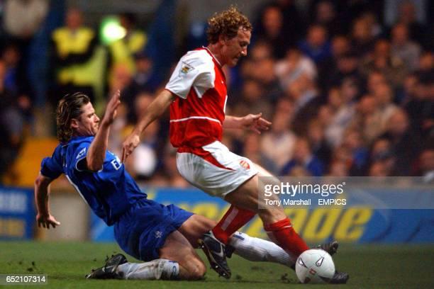 Chelsea's Emmanuel Petit tackles Arsenal's Ray Parlour