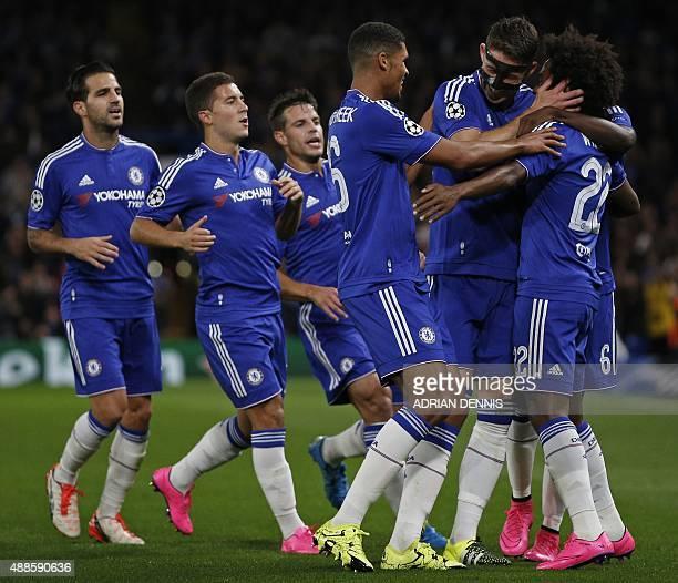Chelsea's English defender Gary Cahill and Chelsea's English midfielder Ruben LoftusCheek congratulate Chelsea's Brazilian midfielder Willian for...