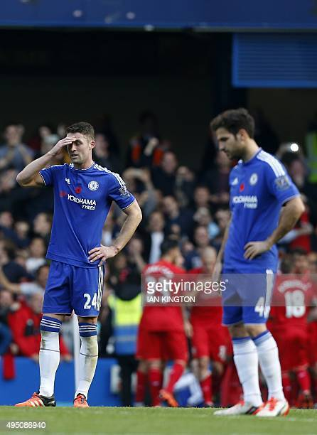 Chelsea's English defender Gary Cahill and Chelsea's Spanish midfielder Cesc Fabregas react after conceding their second goal during the English...