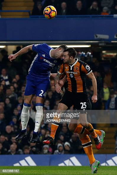 Chelsea's English defender Gary Cahill and Hull City's English midfielder Ryan Mason clash heads during the English Premier League football match...