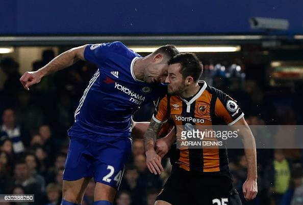TOPSHOT Chelsea's English defender Gary Cahill and Hull City's English midfielder Ryan Mason clash heads during the English Premier League football...