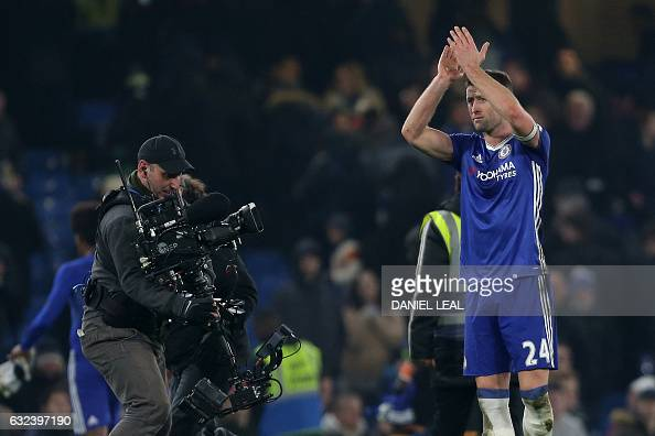 Chelsea's English defender Gary Cahill applauds supporters after the English Premier League football match between Chelsea and Hull City at Stamford...