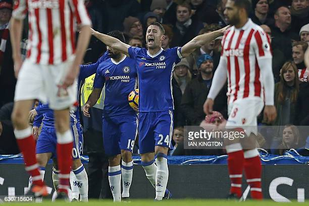 Chelsea's English defender Gary Cahill celebrates after scoring the opening goal of the English Premier League football match between Chelsea and...