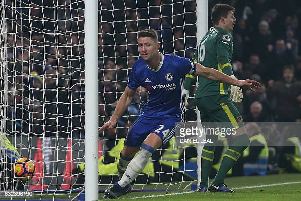 Chelsea's English defender Gary Cahill celebrates after scoring their second goal during the English Premier League football match between Chelsea...