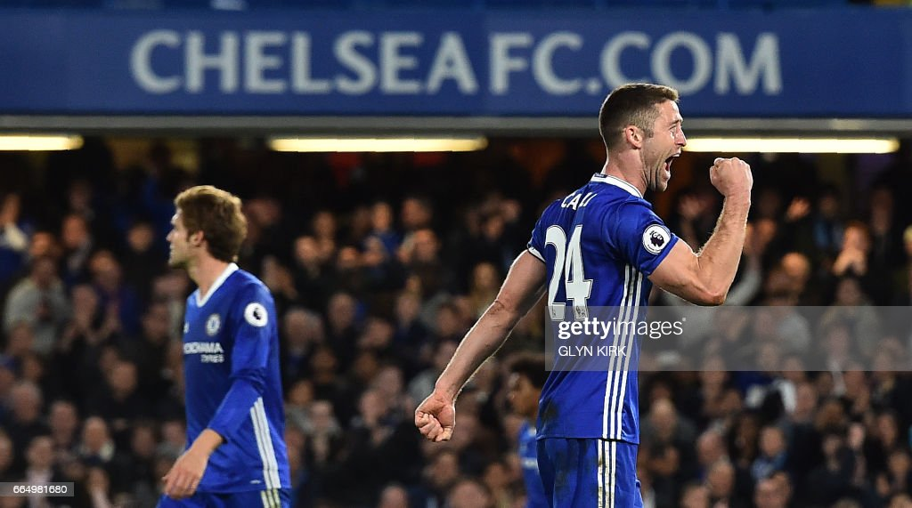 Chelsea's English defender Gary Cahill celebrates moments before the final whistle during the English Premier League football match between Chelsea and Manchester City at Stamford Bridge in London on April 5, 2017. Chelsea won the match 2-1. / AFP PHOTO / Glyn KIRK / RESTRICTED TO EDITORIAL USE. No use with unauthorized audio, video, data, fixture lists, club/league logos or 'live' services. Online in-match use limited to 75 images, no video emulation. No use in betting, games or single club/league/player publications. /