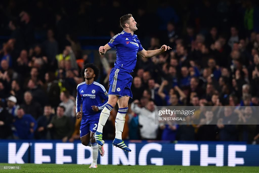 Chelsea's English defender Gary Cahill celebrates scoring their first goal during the English Premier League football match between Chelsea and Tottenham Hotspur at Stamford Bridge in London on May 2, 2016. / AFP / BEN STANSALL / RESTRICTED TO EDITORIAL USE. No use with unauthorized audio, video, data, fixture lists, club/league logos or 'live' services. Online in-match use limited to 75 images, no video emulation. No use in betting, games or single club/league/player publications. /