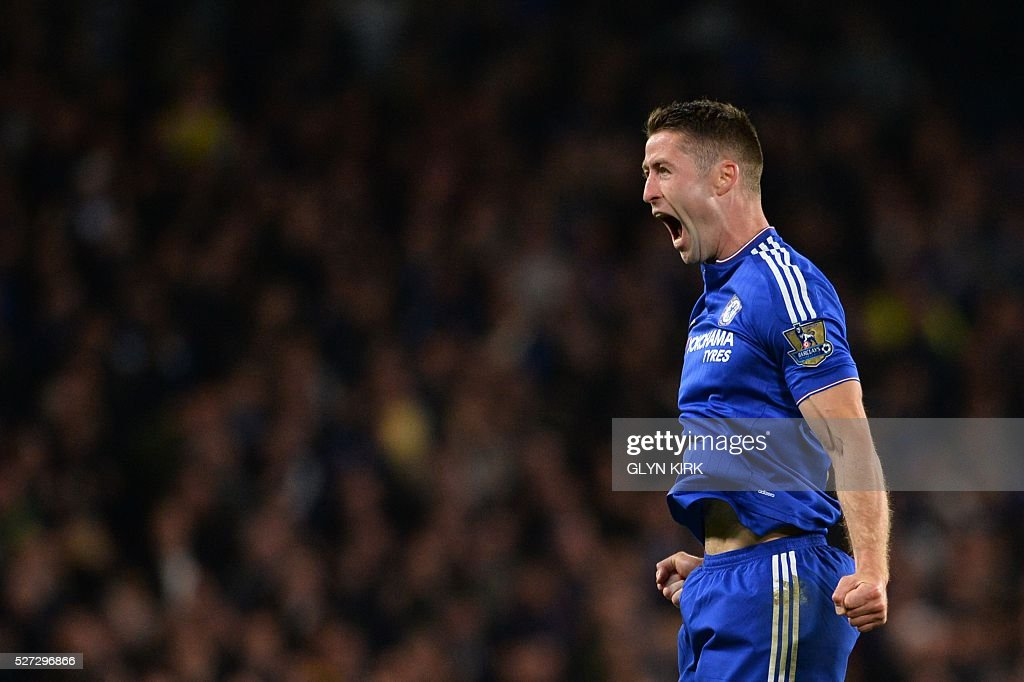 Chelsea's English defender Gary Cahill celebrates scoring their first goal during the English Premier League football match between Chelsea and Tottenham Hotspur at Stamford Bridge in London on May 2, 2016. / AFP / GLYN KIRK / RESTRICTED TO EDITORIAL USE. No use with unauthorized audio, video, data, fixture lists, club/league logos or 'live' services. Online in-match use limited to 75 images, no video emulation. No use in betting, games or single club/league/player publications. /