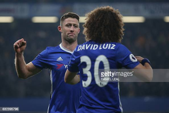 Chelsea's English defender Gary Cahill celebrates with Chelsea's Brazilian defender David Luiz after scoring their second goal during the English...