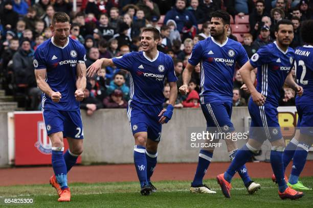 Chelsea's English defender Gary Cahill celebrates with Chelsea's Spanish defender Cesar Azpilicueta after scoring their second goal during the...