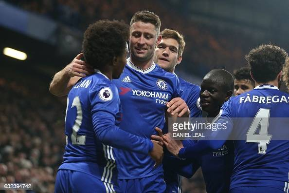 Chelsea's English defender Gary Cahill celebrates with teammates after scoring their second goal of the English Premier League football match between...