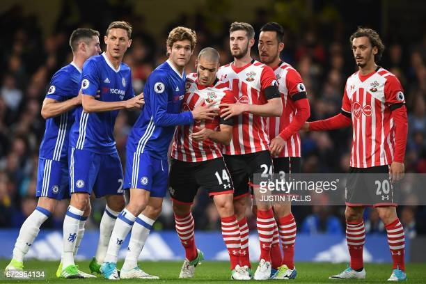 Chelsea's English defender Gary Cahill Chelsea's Serbian midfielder Nemanja Matic and Chelsea's Spanish defender Marcos Alonso Southampton's Sepanish...