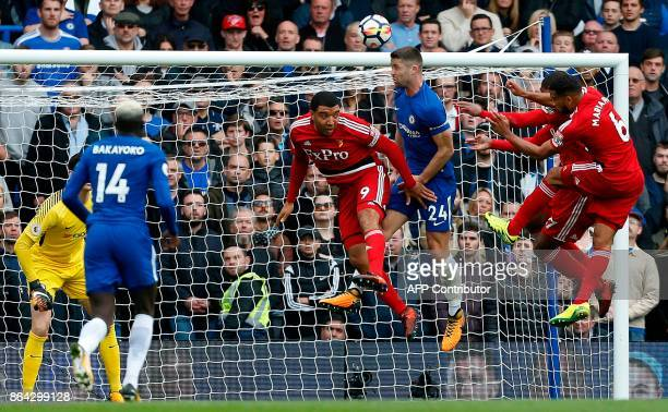 Chelsea's English defender Gary Cahill clears the ball from the line during the English Premier League football match between Chelsea and Watford at...