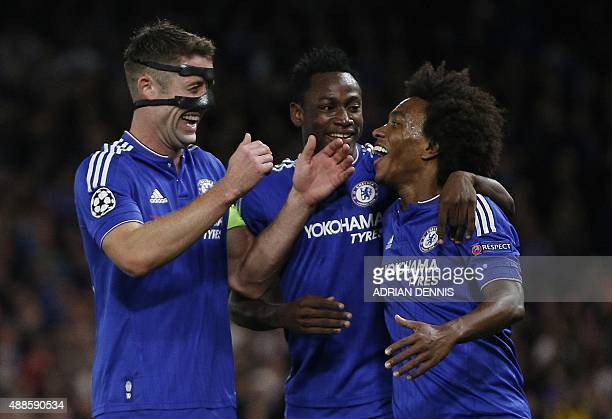 Chelsea's English defender Gary Cahill congratulates Chelsea's Brazilian midfielder Willian for scoring a goal during the UEFA Champions League group...