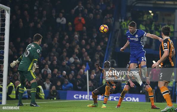 Chelsea's English defender Gary Cahill jumps to head their second goal past Hull City's Swiss goalkeeper Eldin Jakupovic during the English Premier...