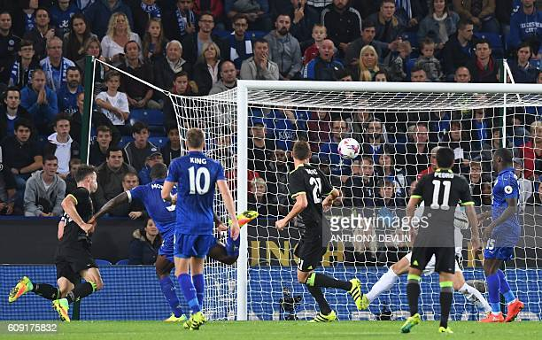 Chelsea's English defender Gary Cahill scores Chelsea's first goal during the English League Cup third round football match between Leicester City...