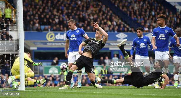 Chelsea's English defender Gary Cahill scores the second goal during the English Premier League football match between Everton and Chelsea at...