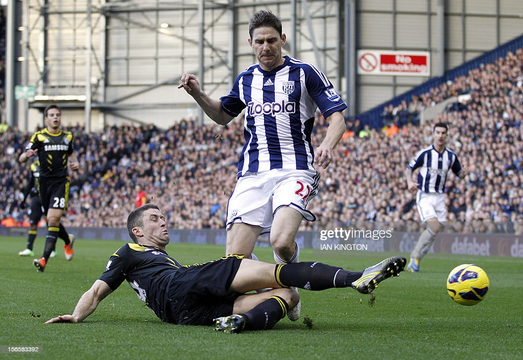 Chelsea's English defender Gary Cahill (L) tackles West Bromwich Albion's Hungarian midfielder Zoltan Gera (R) during an English Premier League football match between West Bromwich Albion and Chelsea at The Hawthorns in West Bromwich on November 17, 2012. USE. No use with unauthorised audio, video, data, fixture lists, club/league logos or 'live' services. Online in-match use limited to 45 images, no video emulation. No use in betting, games or single club/league/player publications.