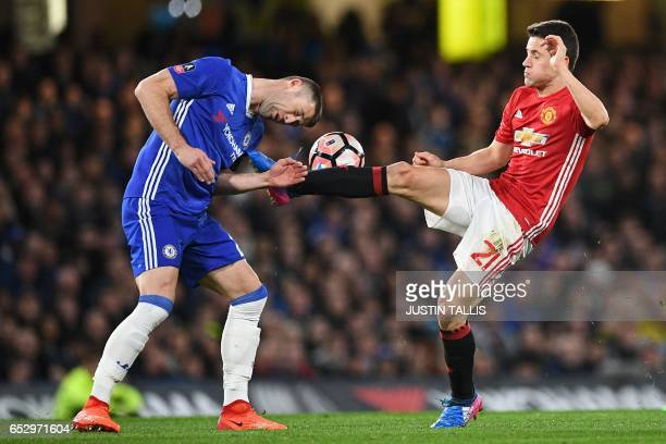 Chelsea's English defender Gary Cahill vies with Manchester United's Spanish midfielder Ander Herrera during the English FA Cup quarter final...