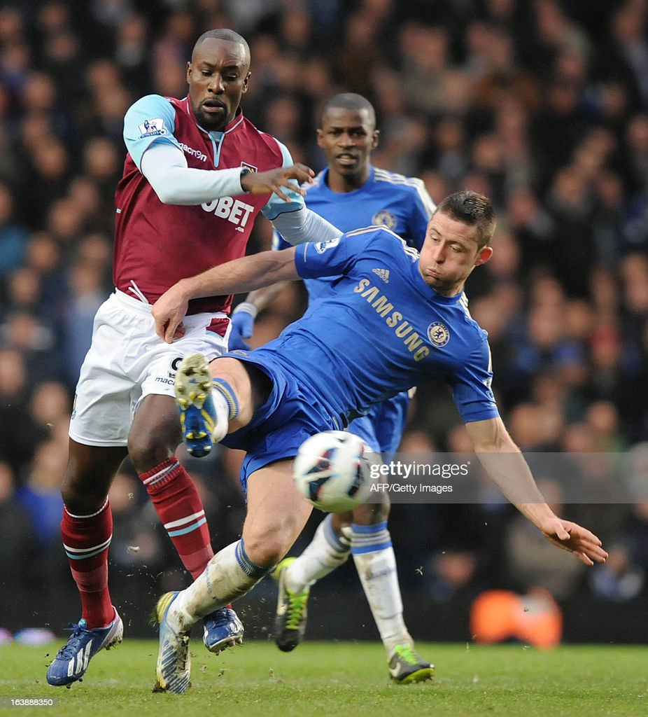 "Chelsea's English defender Gary Cahill (R) vies with West Ham United's English striker Carlton Cole (L) during the English Premier League football match between Chelsea and West Ham United at Stamford Bridge in London on March 17, 2013. USE. No use with unauthorized audio, video, data, fixture lists, club/league logos or ""live"" services. Online in-match use limited to 45 images, no video emulation. No use in betting, games or single club/league/player publications."