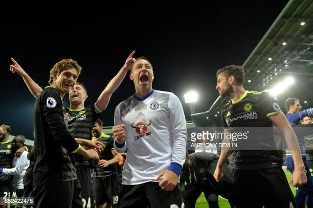 Chelsea's English defender John Terry and Chelsea players celebrate victory after the English Premier League match between West Bromwich Albion and...