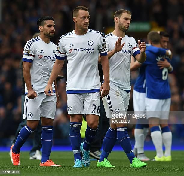 Chelsea's English defender John Terry and Chelsea's Serbian defender Branislav Ivanovic react following the English Premier League football match...