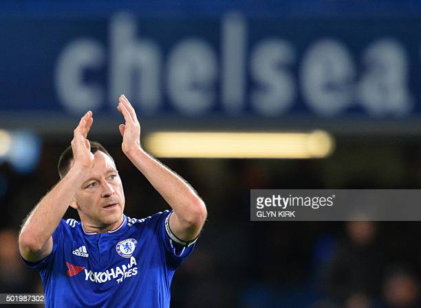 Chelsea's English defender John Terry applauds the fans after winning the English Premier League football match between Chelsea and Sunderland at...