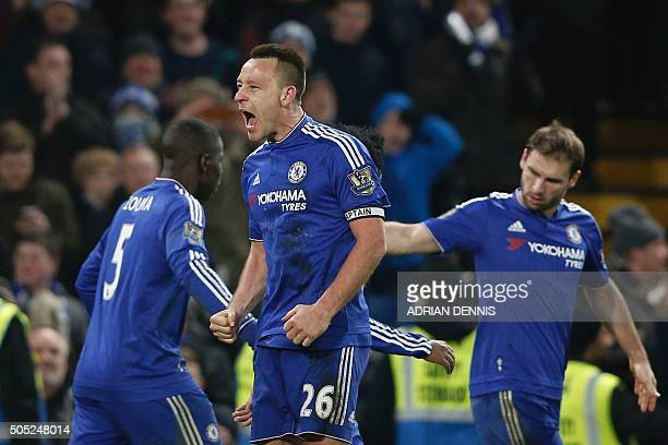 Chelsea's English defender John Terry celebrates scoring a late equalising goal to make the score 33 during the English Premier League football match...