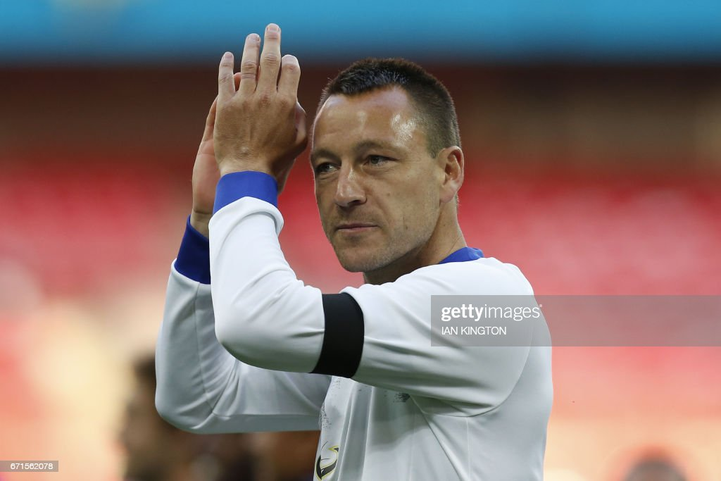 Chelsea's English defender John Terry celebrates victory after the FA Cup semi-final football match between Tottenham Hotspur and Chelsea at Wembley stadium in London on April 22, 2017. / AFP PHOTO / Ian KINGTON / NOT