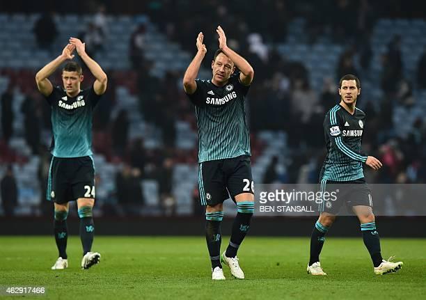 Chelsea's English defender John Terry Chelsea's English defender Gary Cahill and Chelsea's Belgian midfielder Eden Hazard gesture to supporters after...