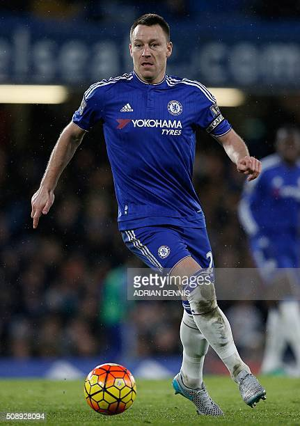 Chelsea's English defender John Terry controls the ball during the English Premier League football match between Chelsea and Manchester United at...