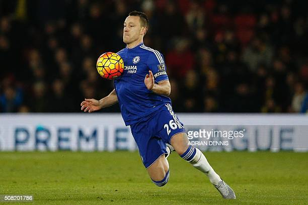 Chelsea's English defender John Terry controls the ball with his chest during the English Premier League football match between Watford and Chelsea...
