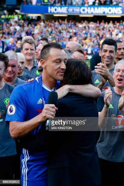 Chelsea's English defender John Terry embraces Chelsea's Italian head coach Antonio Conte as they talk to the stadium during the presentation...
