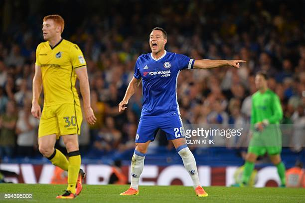 Chelsea's English defender John Terry gestures and shouts to his teammates during the English League Cup second round football match between Chelsea...
