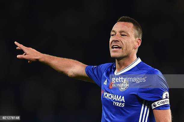 Chelsea's English defender John Terry gestures during the English Premier League football match between Chelsea and Everton at Stamford Bridge in...