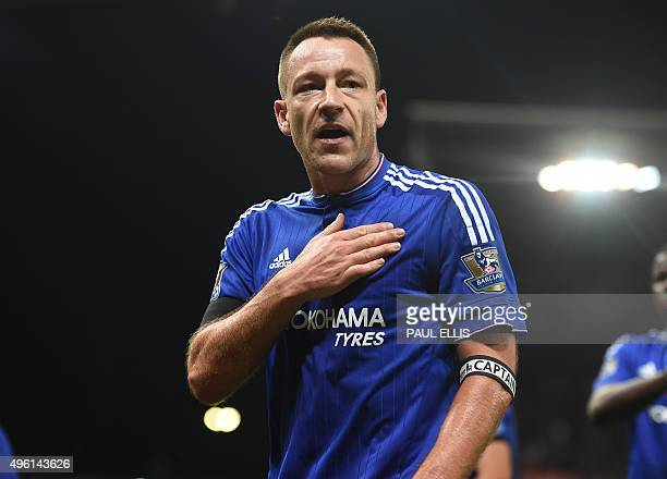 Chelsea's English defender John Terry gestures on the pitch after the English Premier League football match between Stoke City and Chelsea at the...