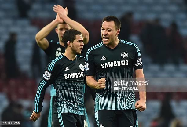 Chelsea's English defender John Terry gestures to supporters after the English Premier League football match between Aston Villa and Chelsea at Villa...