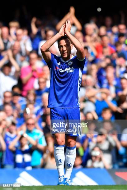Chelsea's English defender John Terry gestures to the crowd as he is substituted off in the 26th minute during the English Premier League football...