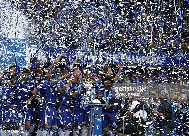 Chelsea's English defender John Terry holds the Premier League trophy with his teammates during the trophy presentation after the English Premier...