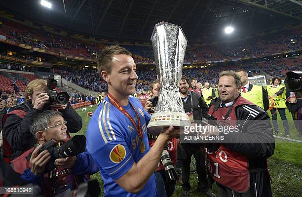 Chelsea's English defender John Terry holds the trophy at the end of the UEFA Europa League final football match between Benfica and Chelsea on May...