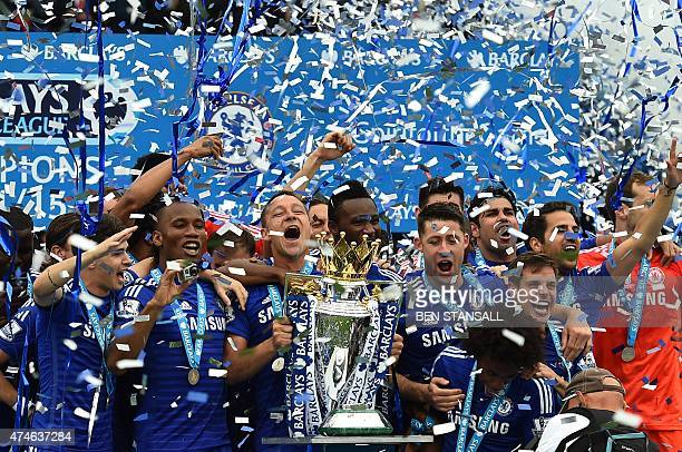 Chelsea's English defender John Terry holds up the trophy during the presentation of the Premier League trophy after the English Premier League...