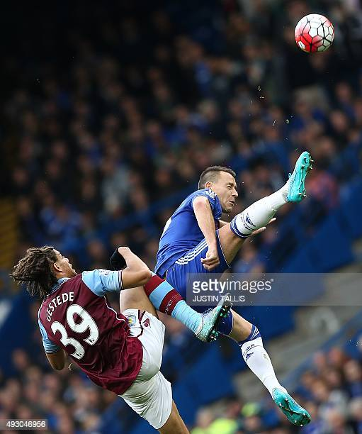 Chelsea's English defender John Terry is challenged by Aston Villa's Frenchborn Beninese striker Rudy Gestede during the English Premier League...