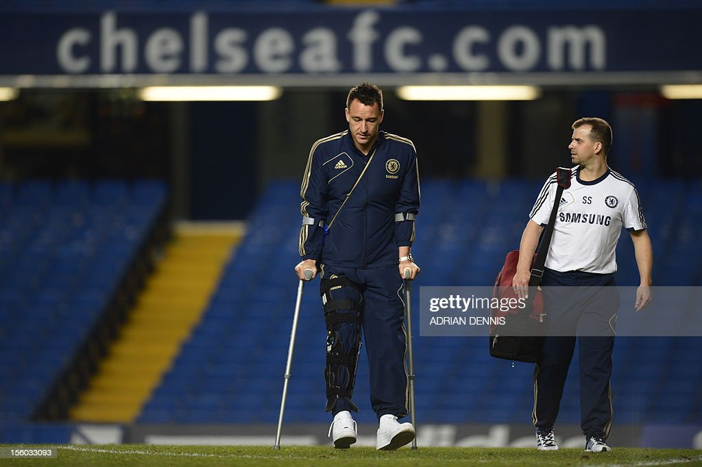 "Chelsea's English defender John Terry (L) is pictured walking on crutches after the English Premier League football match between Chelsea and Liverpool at Stamford Bridge in London, on November 11, 2012. Terry was injured during the match in a collision with Liverpool player Luis Suarez. USE. No use with unauthorized audio, video, data, fixture lists, club/league logos or ""live"" services. Online in-match use limited to 45 images, no video emulation. No use in betting, games or single club/league/player publications."